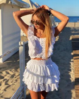 Lekka jak chmurka, uszyta z wysokiej jakości bawełny spódniczka Alice White jest idealnym wyborem na upalne lato i wakacje.